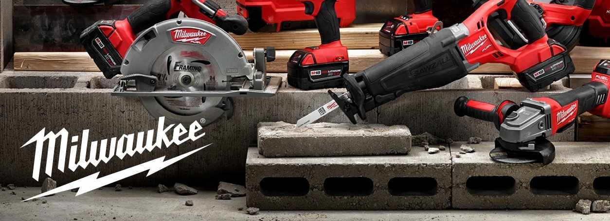 A selection of Milwaukee tools arranged on a dark background.